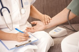 nurse checking a patients pulse